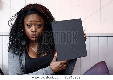 Young Black Woman Holding Small Black Board