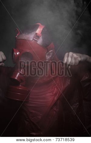 Nuclear, A man in a gas mask over  the smoke. black background and red colors