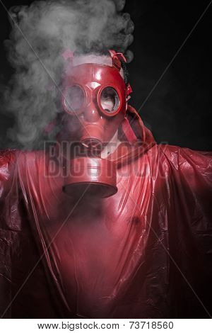 Problem, A man in a gas mask over  the smoke. black background and red colors