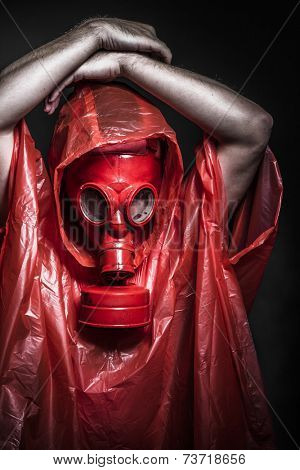 Solitude, A man in a gas mask over  the smoke. black background and red colors