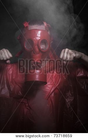 Respirator, nuclear disaster, man with red mask and plastic suit