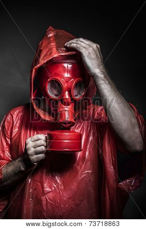 survival nuclear concept, man with red gas mask
