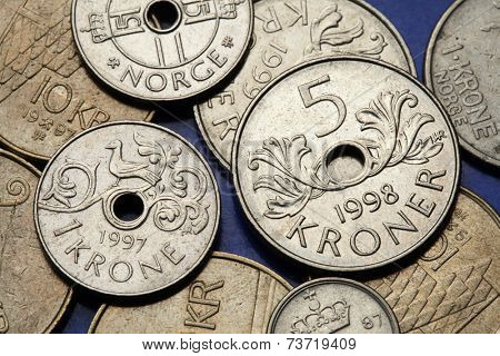 Coins of Norway. Fowl bird depicted in Norwegian one krone coin and Norwegian five kroner coin.