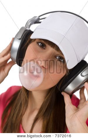 Female Teenager With Bubble Gum And Headphones