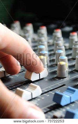 Man Adjusting Audio Mixer