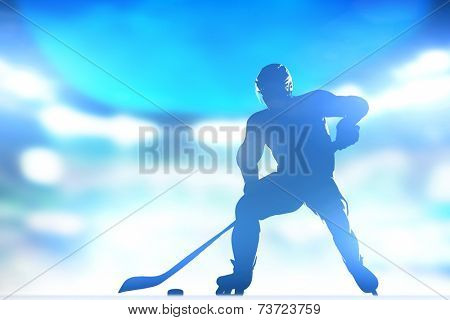 Hockey player skating with a puck. Full arena night lights