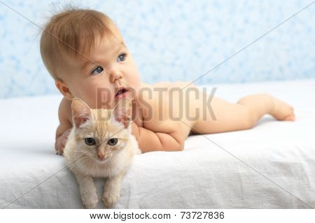 Baby Caught The Cat Lying In Bed