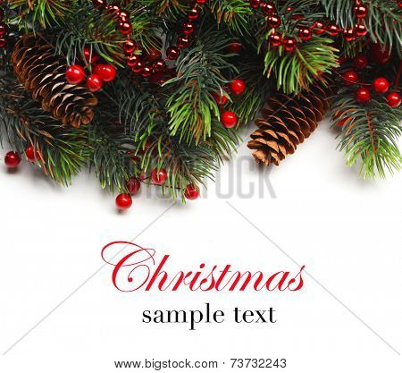 Christmas background. Christmas boarder with fir tree branch with cones and ornament. Close up with copy space  and sample text. Winter holidays concept.