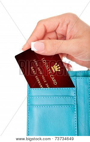 Hand Holding Loyalty Card In Wallet Isolated Over White