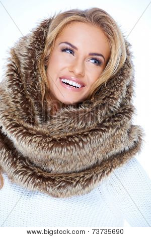 Smiling Blond Woman Wearing Fur Neck Warmer and Looking Up