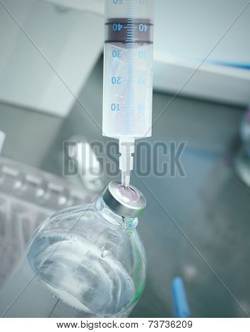 Syringe In The Vial.