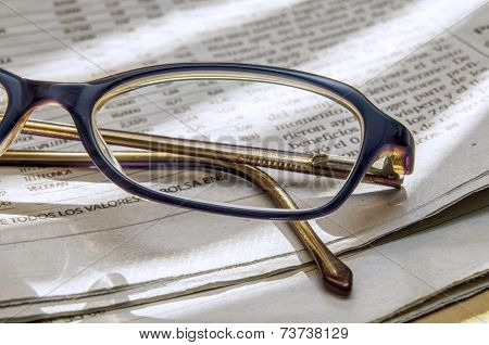 Newspaper And Glasses 1