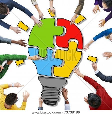 People with Jigsaw Puzzle Forming Light Bulb in Photo and Illustration