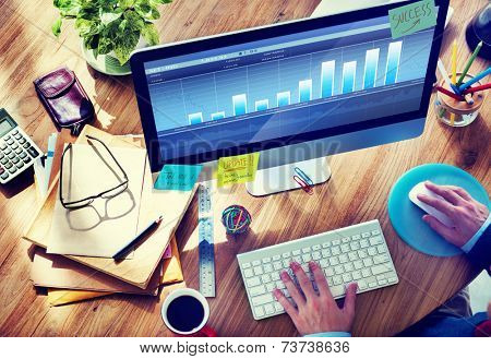 Man Analysis the Market on Computer