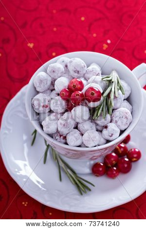 Candied cranberry in a decorative cup