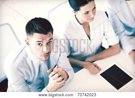 picture of serious businessman on meeting in office