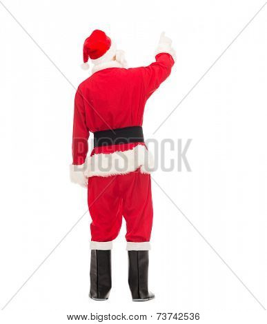 christmas, holidays and people concept - man in costume of santa claus pointing finger from back