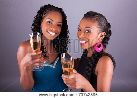 Young Beautiful African Womans Holding A Glass Of Champagne