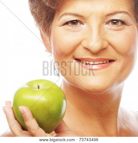 Mature smiling woman with green apple