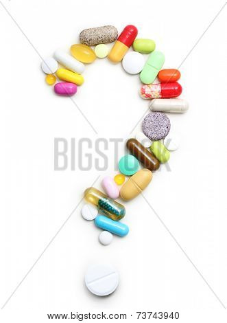 Question sign from pills, various pharmaceuticals isolated on white background.