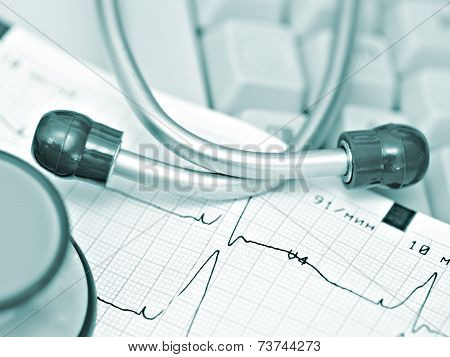 Ecg And Stethoscope Against The Keyboard