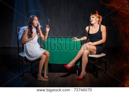 Angel with cigar and devil on dark background