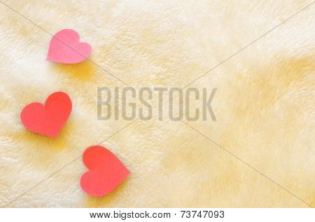 Three Hearts On Wool Background
