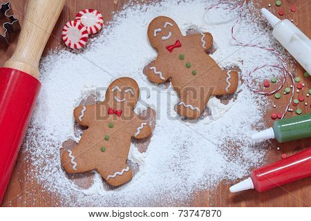 gingerbread man making a snow angel