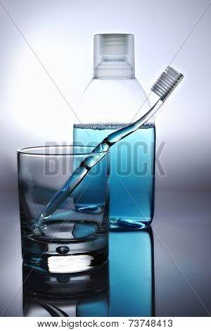 Toothbrush, Mouthwash And Glass
