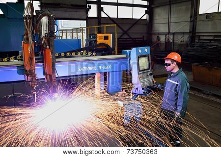 Worker Standing Near The Machine Control Panel Plasma Metal Cutting.