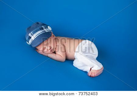 Newborn Baby Boy With Blue Cap