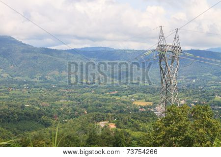 High Voltage Towers On Mountain