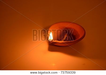 A classic indian earthen lamp glowing in dark