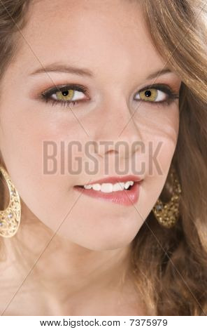 Headshot Of Teenager Biting Lower Lip