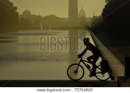 Morning haze and biker's silhouette in National Mall - Washington DC, United States of America