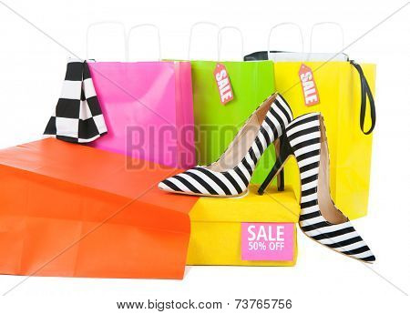 Sale shopping concept, high heels with box and shopping bags