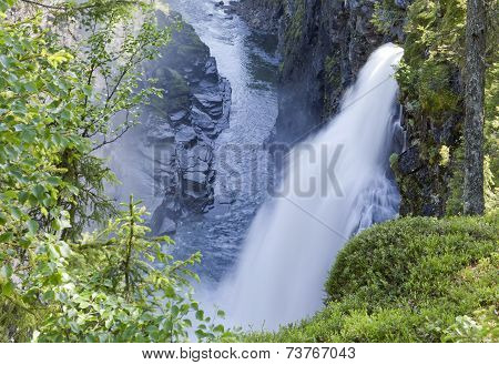 Waterfall in rural countryside.