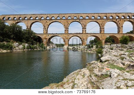 Pont du Gard is an old Roman aqueduct near Nimes in Southern France