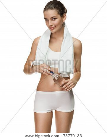 Tempting woman with plastic bottle of water after workout