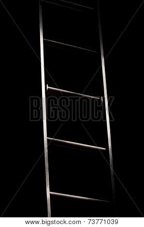 An abstract, high contrast image of ladder leading from light to dark
