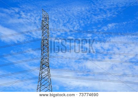 High-voltage power pole and the sky.