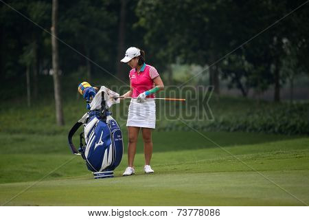 KUALA LUMPUR, MALAYSIA - OCTOBER 10, 2014: Park Hee Young of South Korea select her club to play at the ninth hole of the KL Golf & Country Club at the 2014 Sime Darby LPGA Malaysia golf tournament.