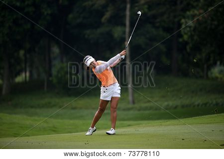 KUALA LUMPUR, MALAYSIA - OCTOBER 11, 2014: Jenny Shin of the USA makes a shot from the fairway of the ninth hole of the KL Golf & Country Club during the 2014 Sime Darby LPGA Malaysia golf tournament.