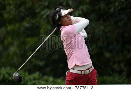 KUALA LUMPUR, MALAYSIA - OCTOBER 11, 2014: K. Muangkhumsakul of Thailand tees off at the fourth hole of the KL Golf & Country Club during the 2014 Sime Darby LPGA Malaysia golf tournament.