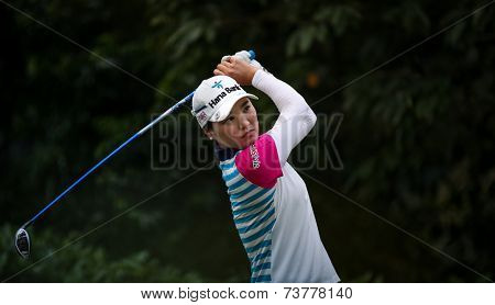 KUALA LUMPUR, MALAYSIA - OCTOBER 11, 2014: So Yeon Ryu of South Korea tees off at the fourth hole of the KL Golf & Country Club during the 2014 Sime Darby LPGA Malaysia golf tournament.