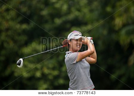 KUALA LUMPUR, MALAYSIA - OCTOBER 10, 2014: Haeji Kang of South Korea reacts after teeing off at the sixth hole of the KL Golf & Country Club at the 2014 Sime Darby LPGA Malaysia golf tournament.