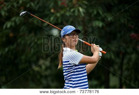 KUALA LUMPUR, MALAYSIA - OCTOBER 11, 2014: Lydia Ko of New Zealand reacts after  teeing off at the fourth hole of the KL Golf & Country Club during the 2014 Sime Darby LPGA Malaysia golf tournament.