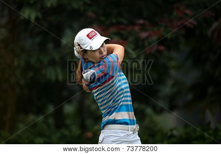 KUALA LUMPUR, MALAYSIA - OCTOBER 11, 2014: Sun Young Yoo of South Korea tees off at the fourth hole of the KL Golf & Country Club during the 2014 Sime Darby LPGA Malaysia golf tournament.