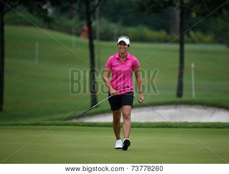 KUALA LUMPUR, MALAYSIA - OCTOBER 11, 2014: Marina Alex of the USA reacts after her put at the third hole of the KL Golf & Country Club during the 2014 Sime Darby LPGA Malaysia got tournament.