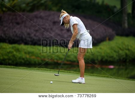 KUALA LUMPUR, MALAYSIA - OCTOBER 10, 2014: Natalie Gulbis of the USA putts the ball to the 18th hole of the KL Golf & Country Club at the 2014 Sime Darby LPGA Malaysia golf tournament.